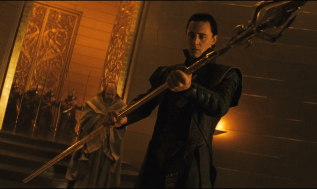 Loki holds Odins spear Gungnir