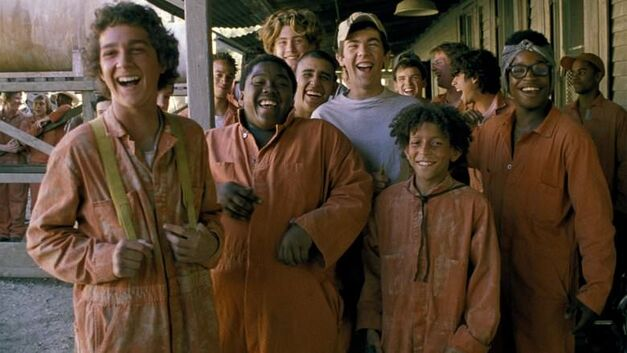 holes full cast in dusty orange jumpsuits