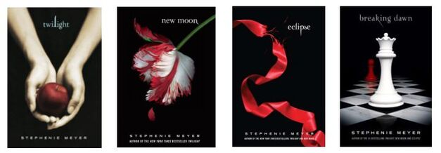 All four of the book covers of the Twilight series shown together in a row.