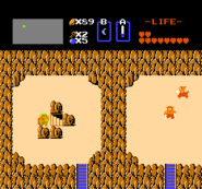 312913-the-legend-of-zelda-nes-screenshot-moving-a-boulder-and-finding