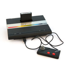 Atari 7800 with cartridge and controller