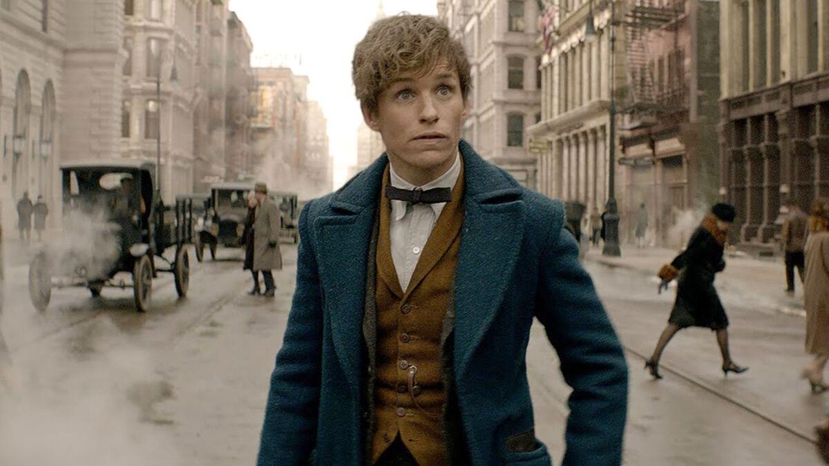 Newt walks on a city street