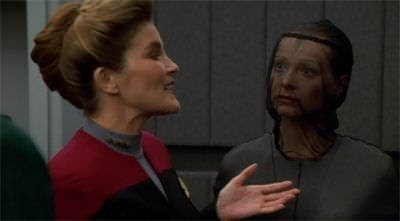 star-trek-voyager-innocence-captain janeway chats with lady who looks like a beekeeper