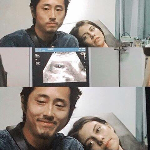 Glenn and Maggie looking at a sonogram of their baby