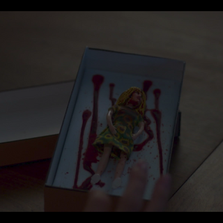 Jennie receiving blood-soaked Kelly Taylor doll in The Pitch