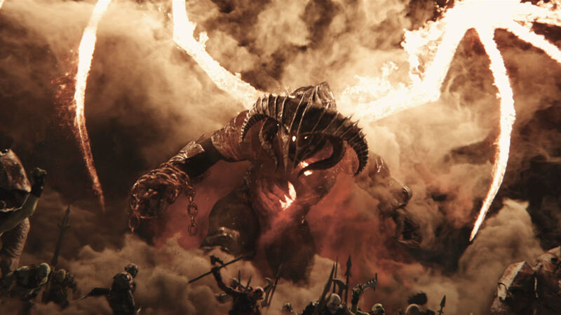 The balrog towers over normal orcs