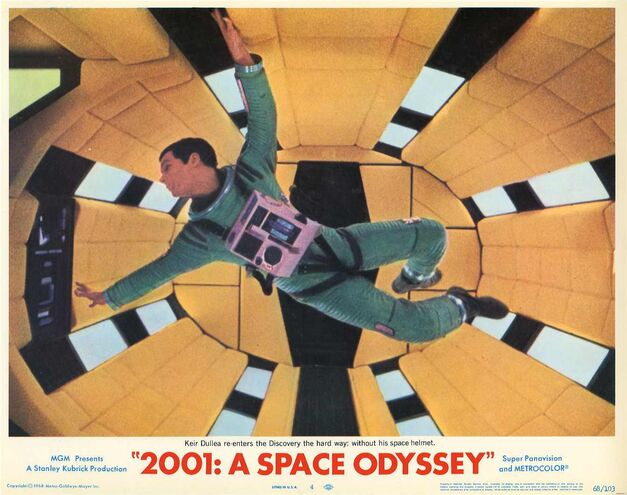 This is an old movie poster that depicts an astronaut in the center of the frame, floating inside a spaceship.