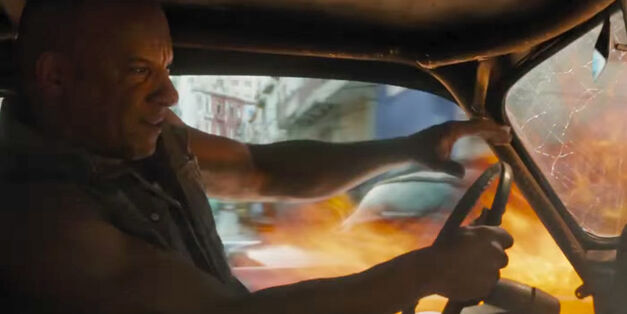 Vin-Diesel-as-Dominic-Toretto-in-The-Fate-of-the-Furious car on fire