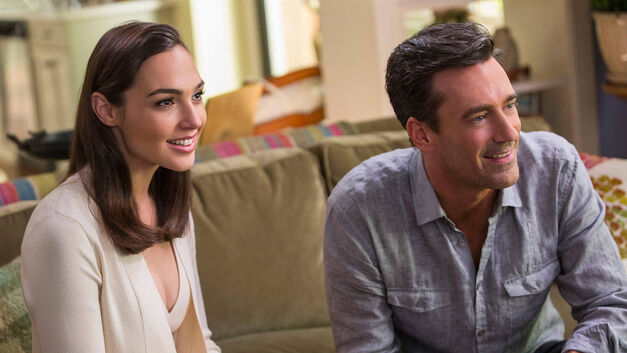 Gal Gadot and Jon Hamm the perfect suburban couple in their perfect suburban living room