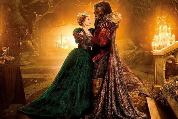 Belle and the Beast dance in candlelit cave in Christophe Gans