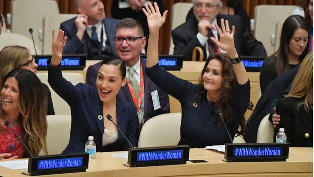 NEW YORK, NY - OCTOBER 21: Actors Gal Gadot (L) and Lynda Carter wave to the audience at the Wonder Woman UN Ambassador Ceremony at United Nations on October 21, 2016 in New York City. (Photo by Mike Coppola/WireImage)