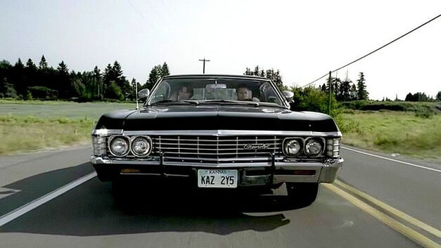 Supernatural black Chevrolet 67 Impala driving on the road