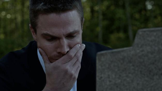 Oliver_shedding_tears_over_a_grave