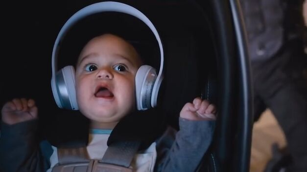baby with headphones on in fate of the furious
