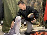 Kazutoki Kono Posing With Cossette's Dog