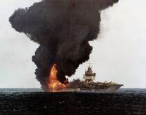 1200px-USS Enterprise (CVN-65) burning, stern view