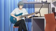 Sosuke playing with his guitar