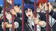 Kakeru, Itto, Hozumi, and Takato pushing against the gates