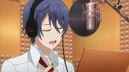 Saku singing in the studio