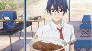 Saku offering his curry plate to Kai