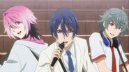 Saku, Sosuke, and Uta singing side by side during filming