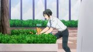 Rei placing Minori as a cat in the bushes