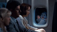 Pubert Addams greets The Buckmans on a plane