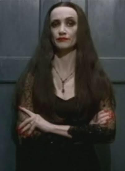 morticia addams cutting roses