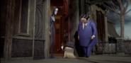 Cousin Itt, Gomez and Morticia in The Addams Family 2019 Film