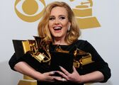 Musician-adele-poses-with-her-six-trophi-1