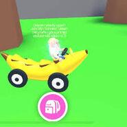 Player riding banana car