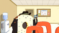 S6e15 Donut Guy holding device.png