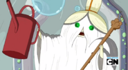 S5 e26 Grand Master Wizard holding up watering can