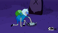 S1e1 finn pushing zombie into hole.png