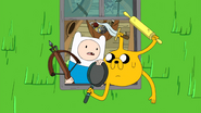 S7e33 Finn and Jake wielding weapons