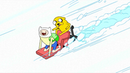 S1e3 finn and jake sledding on chair