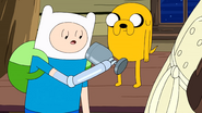 S10e2 Finn and Jake looking at goblet