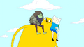 S3e3 Jake carrying Finn and Rag Wizard.png
