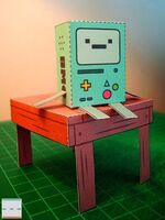 BMO papercut out sitting on table