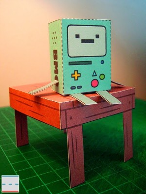 File:BMO papercut out sitting on table.jpg