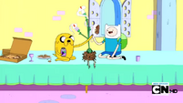 S2e17 Finn and Jake high-fiving over Princess Plant