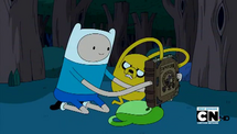 S4e7 finn and jake holding the enchiridion