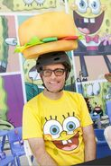 Tom Kenny wearing a Crabby Patty