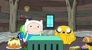 S3e19 Finn and Jake watching videotape