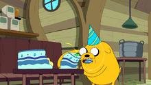 Jake gobbling up cake