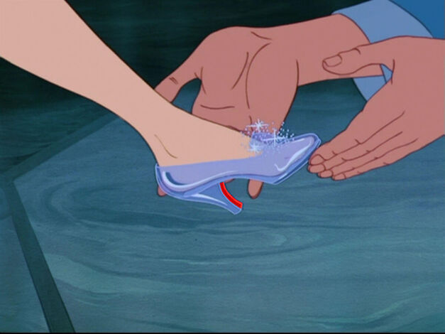 prince puts shoes on cinderella