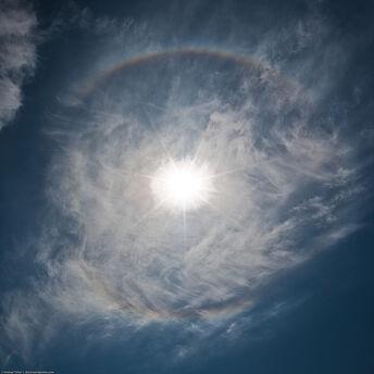 Halo, 22-degree halo, Solar Halo, 22 degree solar halo - aka (incorrectly) Rainbow, Full Circle, 360 Degree, Round, Circular, Whole. Directly overhead. Morro Bay, CA. 12 June 2009.