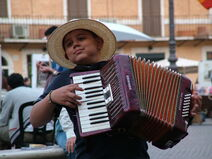 Accordion playing boy in Rome