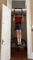 Pull-up-on-doorway-bar-with-weight-belt