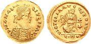 Pièce en or grossièrement frappée avec le profil d'un homme portant une toge